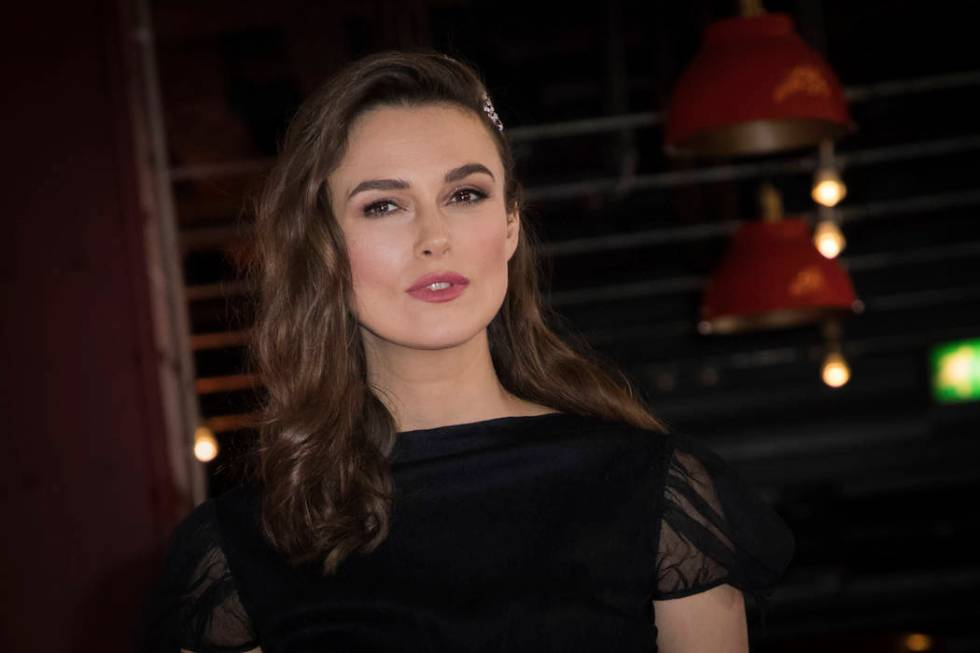Actress Keira Knightley poses for photographers upon arrival at the premiere of the film 'The A ...