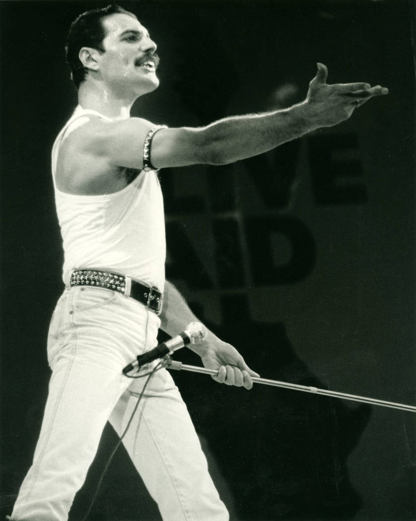Freddy Mercury with Queen on stage at Live Aid on 13 July 1985 at Wembley Stadium, London. (AP ...