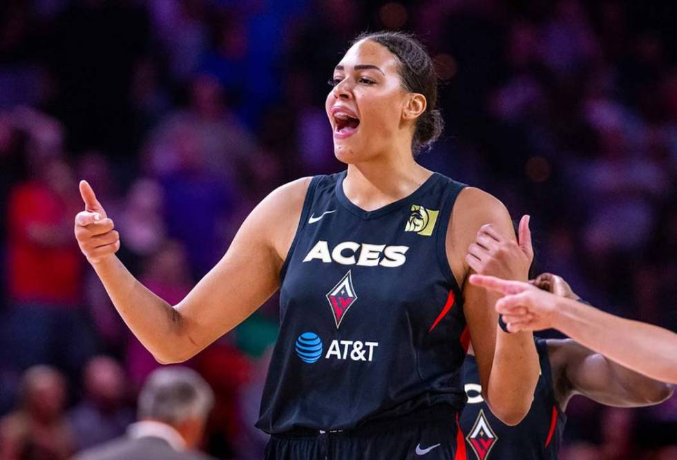 Las Vegas Aces center Liz Cambage (8) pumps up her teammates during the overtime period versus ...