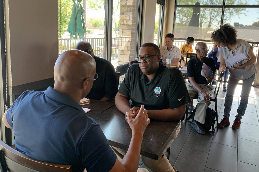 Las Vegas City Councilman Cedric Crear speaks with an attendee at his Coffee with Councilman Cr ...