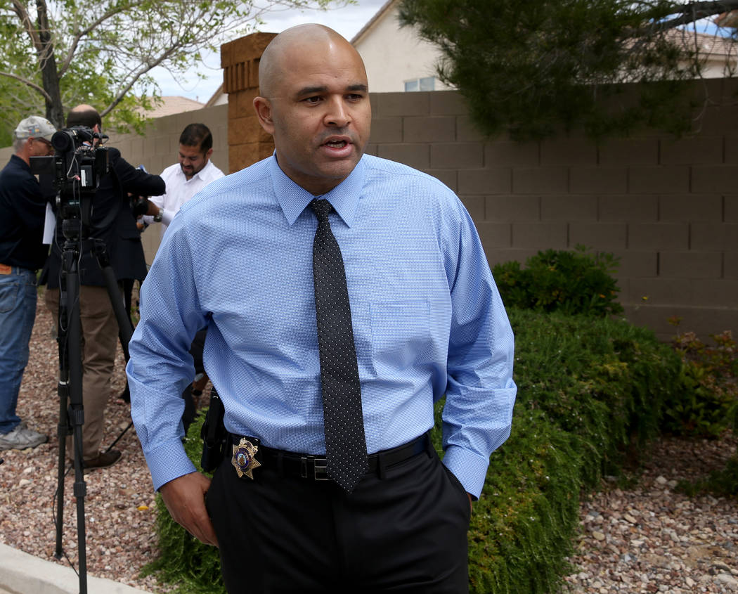 Las Vegas police homicide Lt. Ray Spencer talks to a reporter regarding a shooting in a gated c ...