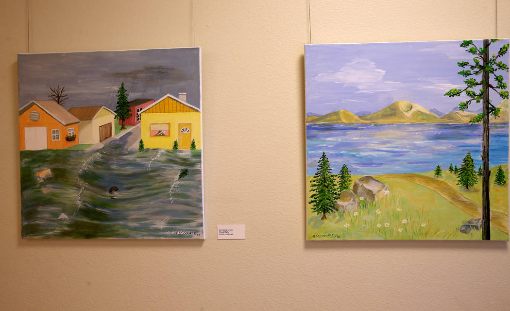 Flood Water, left, and Lake Water acrylic on canvas paintings are part of Hannelore Lowrey's ex ...
