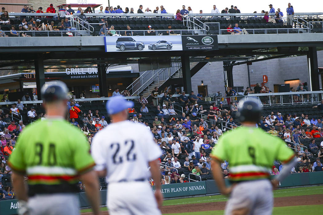 "Fans watch as the Las Vegas Aviators compete against Round Rock Express while playing in "" ..."
