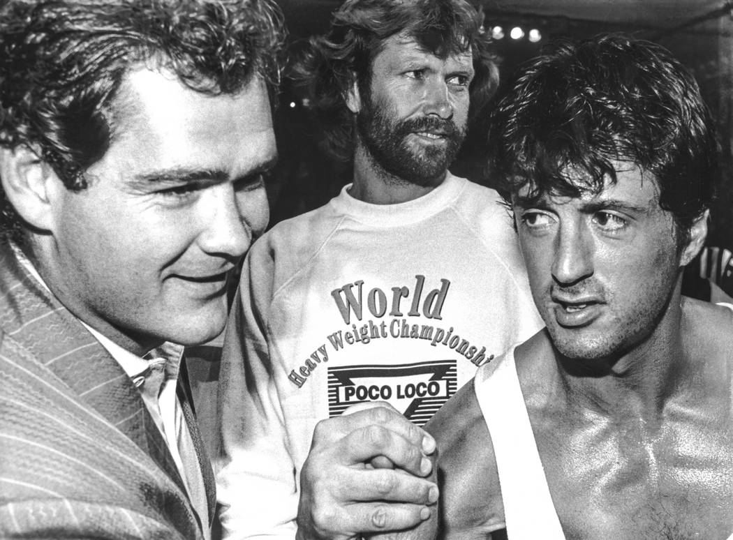 Sylvester Stallone, right, arm wrestles Stephan Tanstad at the Las Vegas Hilton in Las Vegas in ...