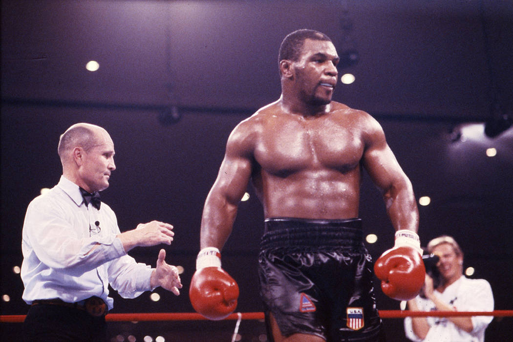 Undefeated Mike Tyson defeated Tony Tucker in a unanimous 12-round decision and he became the u ...