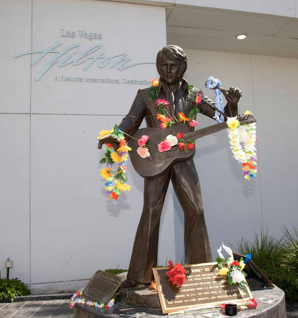 The statue of Elvis located at the Las Vegas Hilton was decorated by fans for the anniversary o ...