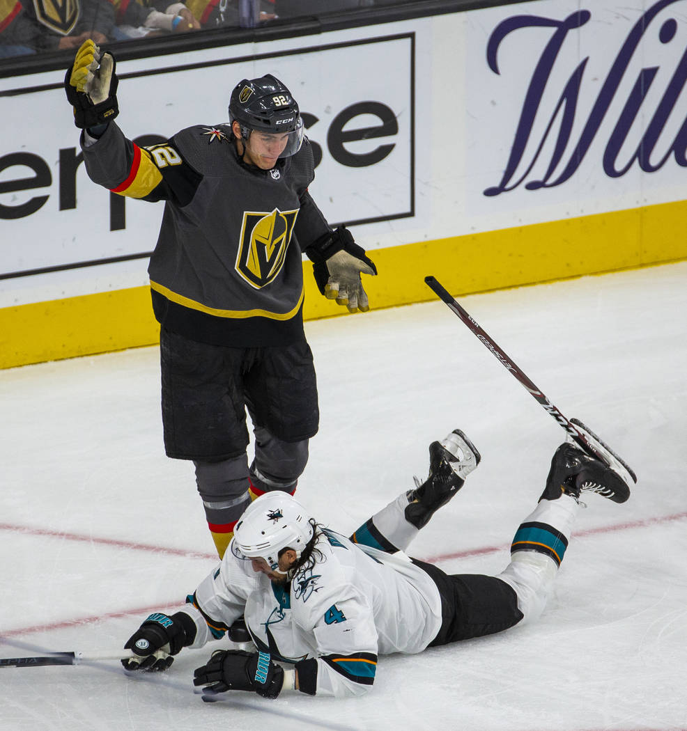 Golden Knights left wing Tomas Nosek (92) has his stick stuck in the skate of San Jose Sharks d ...