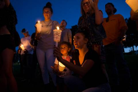 Ripley Rose Garcia, 2, stands with her mother, Alexis Mendoza, right, during a vigil for her fa ...