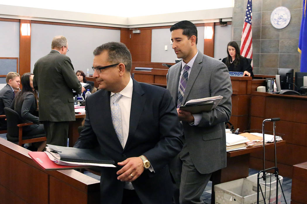 Defense lawyer Christopher Oram, left, who represents former LVCVA executive Brig Lawson, and C ...