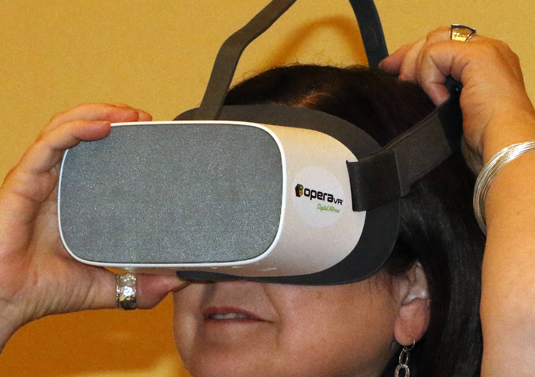 Diana Casey of Philadelphia, checks out how virtual reality headsets is used in dentistry durin ...