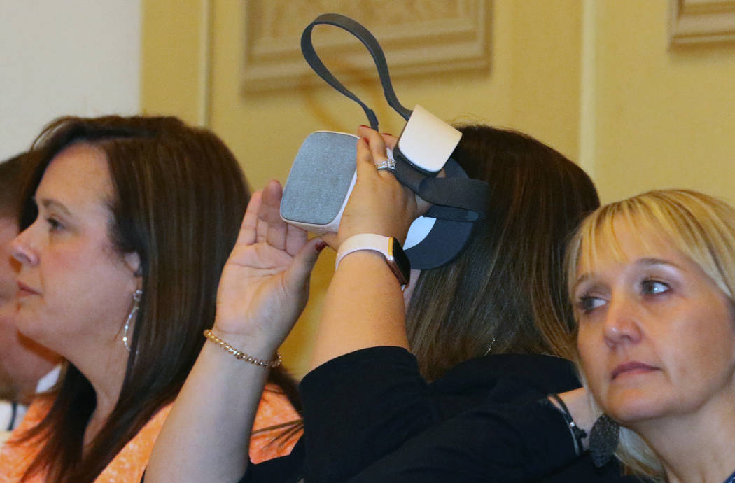 Shana Foster, enter, checks out how virtual reality headsets is used in dentistry during Paters ...