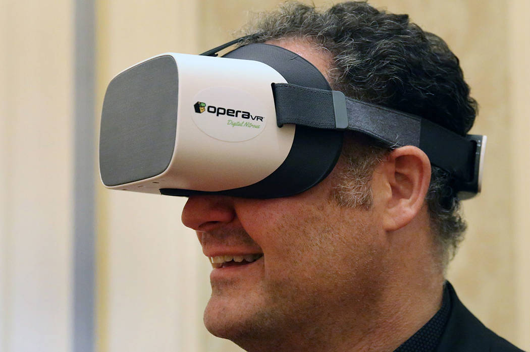 Dr. Bryan Laskin, chief operation officer, Dental Care Alliance, demonstrates how virtual reali ...