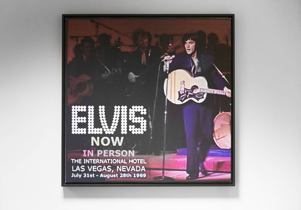 A framed ad for an Elvis Presley show at the International Hotel in 1969 hangs on the wall in t ...