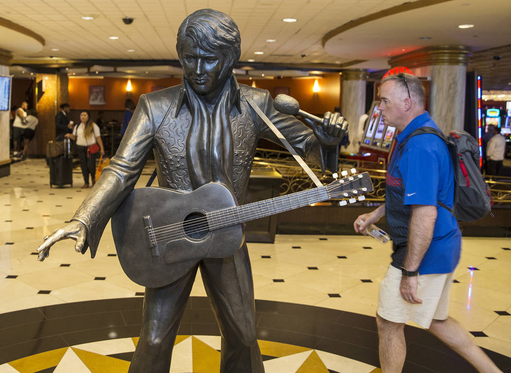 Guests pass by an Elvis Presley statue in the lobby of the Westgate on Thursday, July 11, 2019, ...