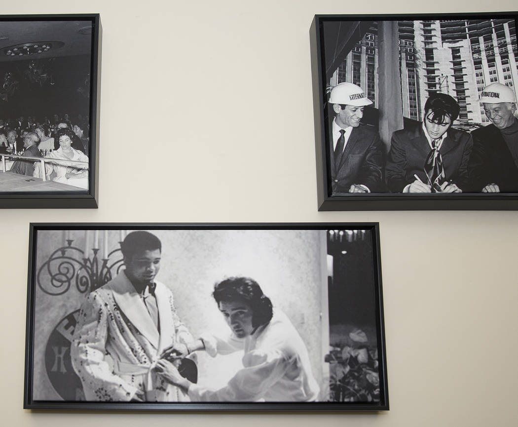 Prints of famous photographs of Elvis Presley hang on the wall in the administrative offices of ...