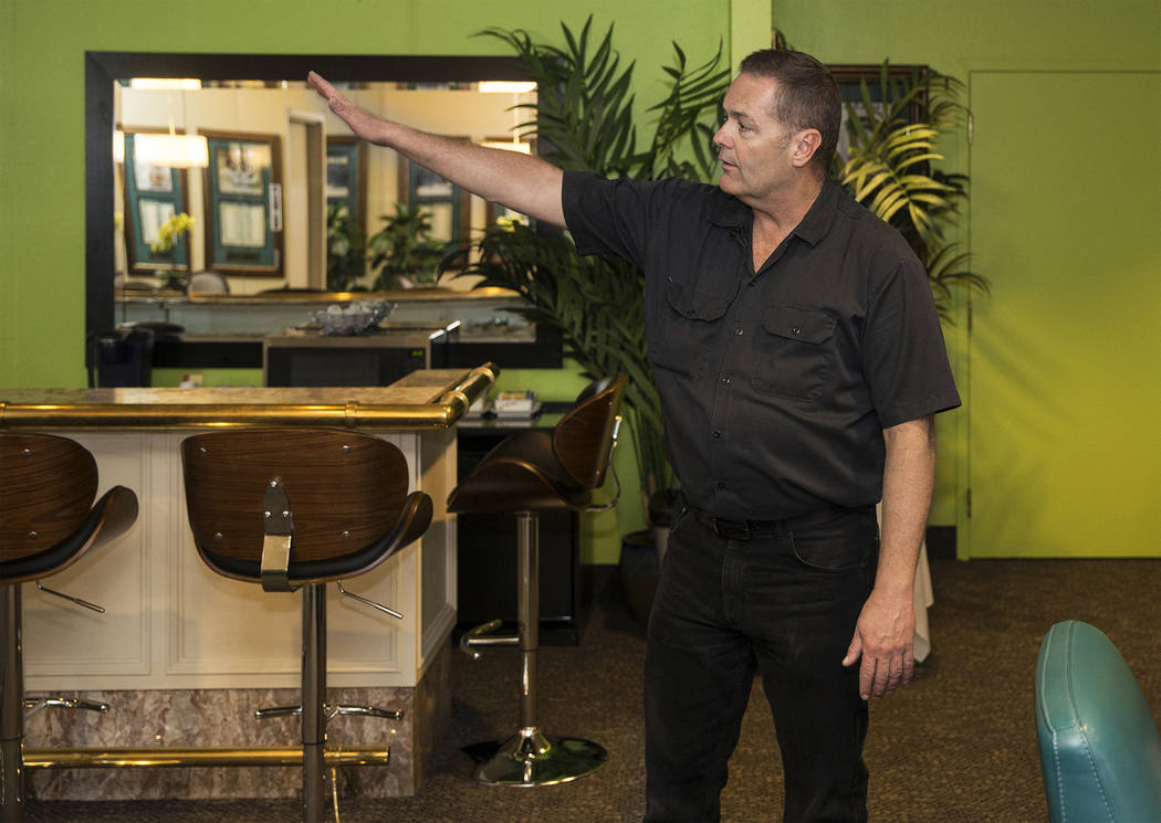 Craig Hayes, crew chief and head carpenter at the International Theater, points out features of ...