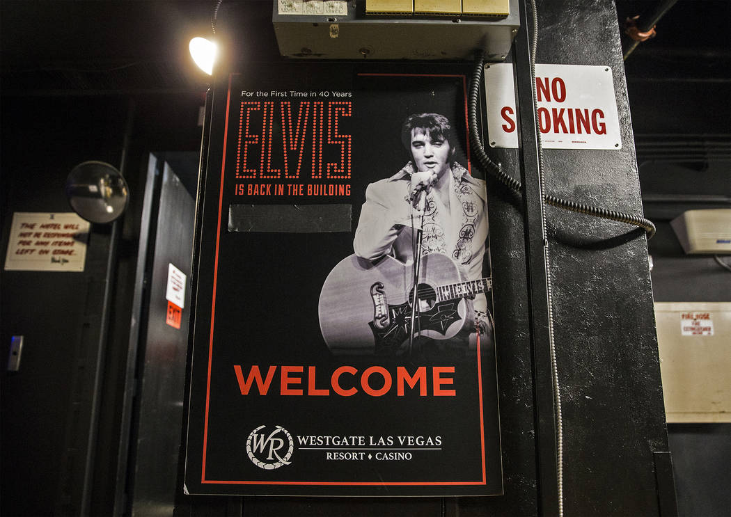A poster of Elvis Presley hangs backstage at the International Theater on Thursday, July 11, 20 ...