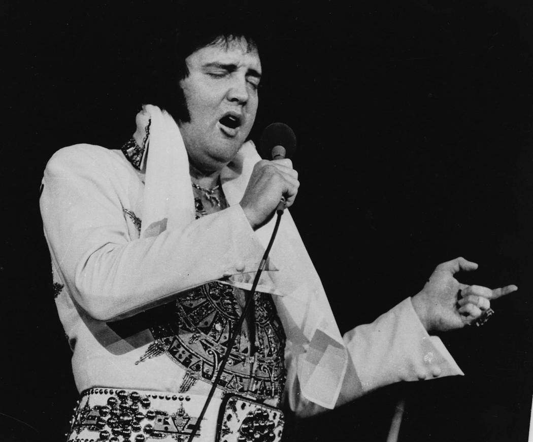 Elvis Presley is shown performing in Providence, R.I. on May 23, 1977, three months before his ...