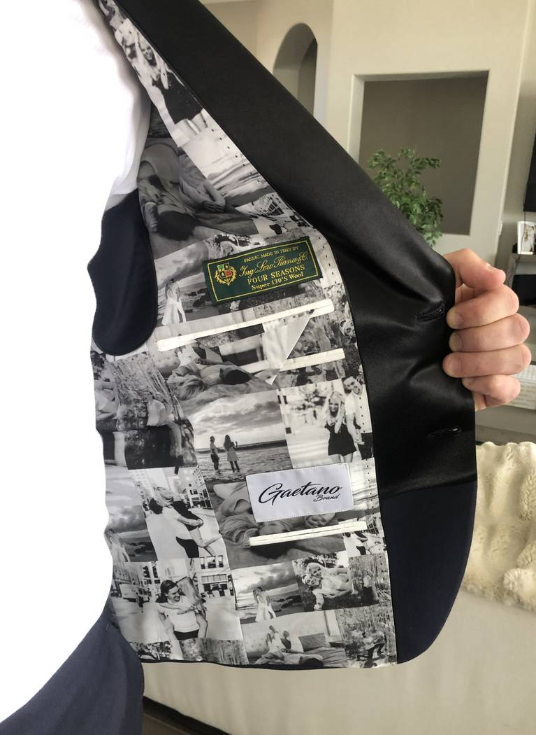 Erik Haula shows off the customized lining of the suit jacket he wore for his wedding to Kriste ...
