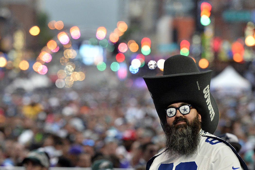 A Dallas Cowboys fan stands during the 2019 NFL Draft Thursday, Apr. 25, 2019, in Nashville, Te ...