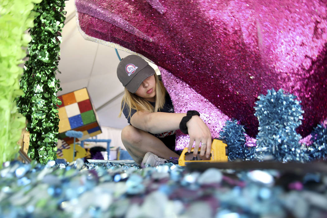 "Jordyn Doyle works on the ""Undersea Jubilee"" float during a media preview of the 25th annual Su ..."