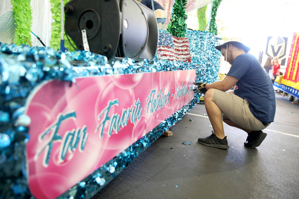 "Julien Mihy works on the ""Undersea Jubilee"" float during a media preview of the 25th annual Sum ..."