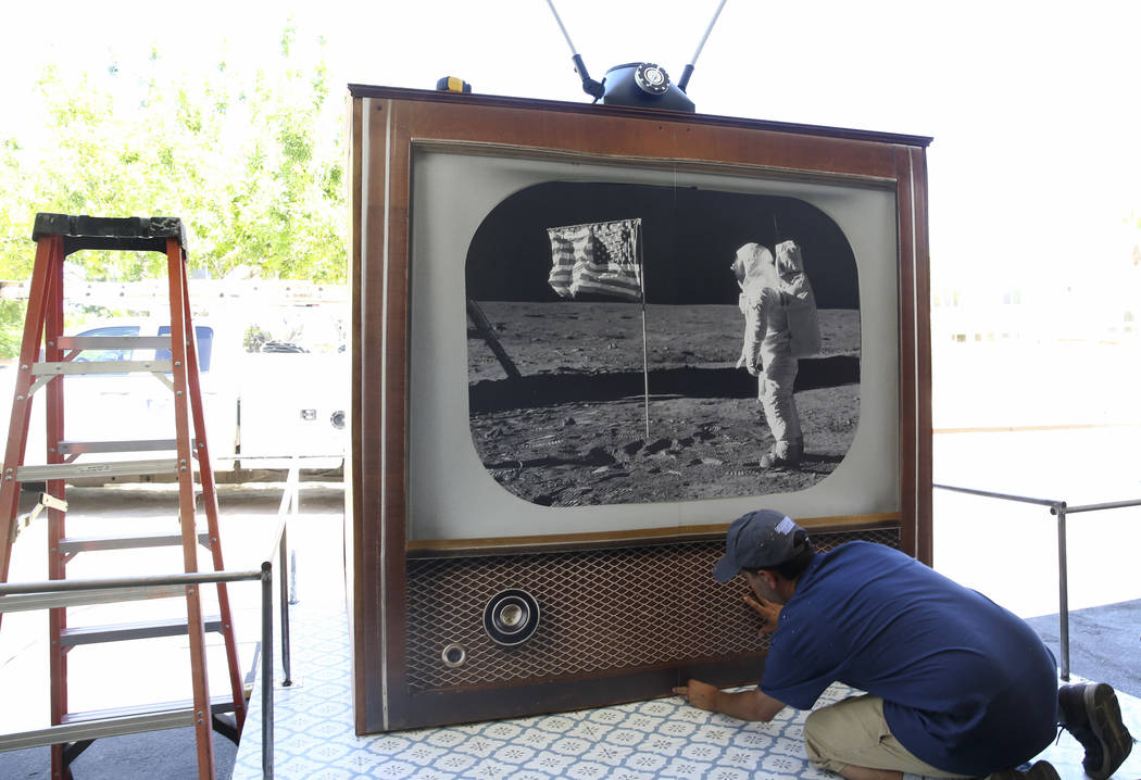 "Dave Bailey works on ""Apollo Moon Landing 50th Anniversary"" float during a media preview of the ..."