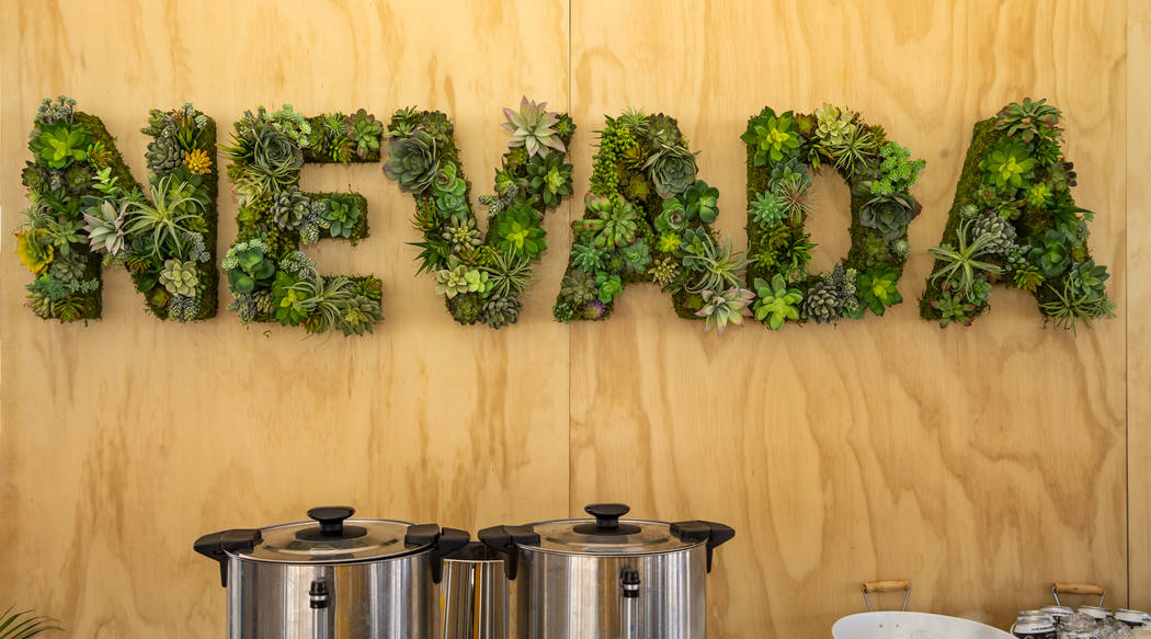 A Nevada sign made of live plants hangs on the wall during a Google Nevada data center investme ...