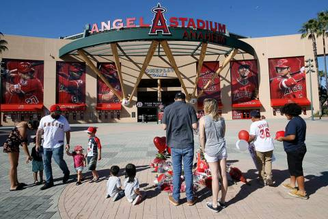 Los Angeles Angel mourners stand at a memorial to give their condolences for pitcher Tyler Skag ...