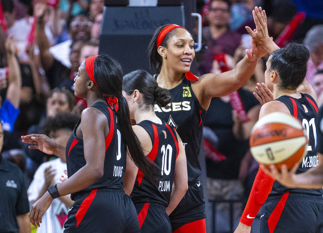Las Vegas Aces center A'ja Wilson (22) celebrates a win with teammates after their overtime vic ...