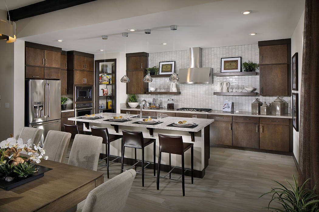 The epicurean kitchen features a central island, walk-in pantry and two-toned counters. (Anthon ...