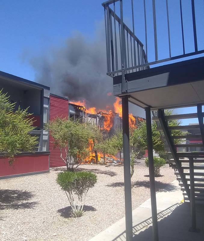 The Clark County and Las Vegas fire departments are fighting a fire at an apartment complex at ...