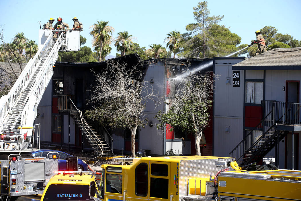 Clark County firefighters douse a three-alarm fire at an apartment complex at 5100 E. Tropicana ...