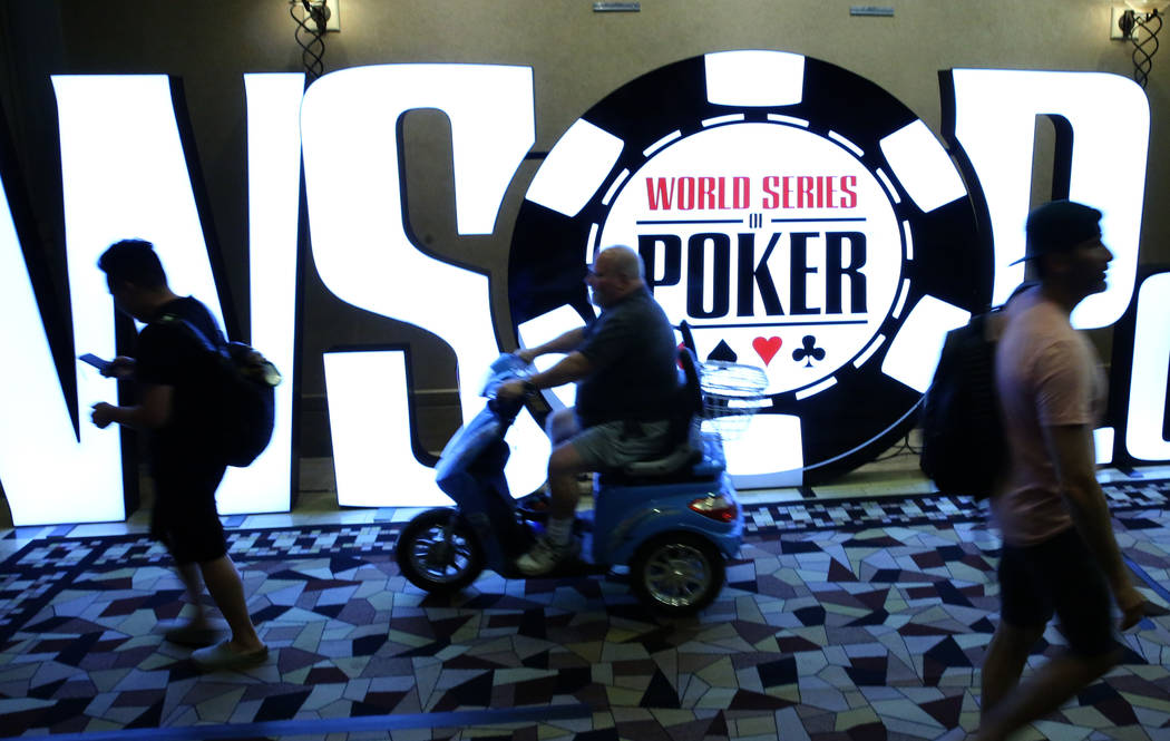 Players walk past the World Series of Poker Tournament (WSOP) sign during the 2019 WSOP tournam ...