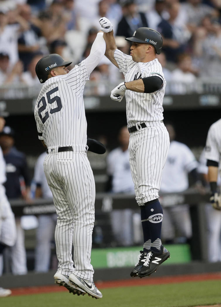 New York Yankees' Brett Gardner, right, celebrates after hitting a two-run home run with Gleybe ...