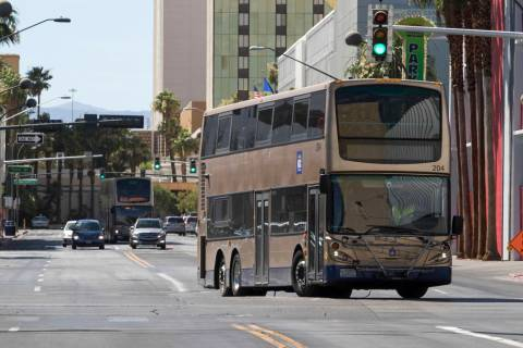 An RTC bus turns onto North Las Vegas Blvd. from E. Carson Ave. in downtown Las Vegas on Friday ...