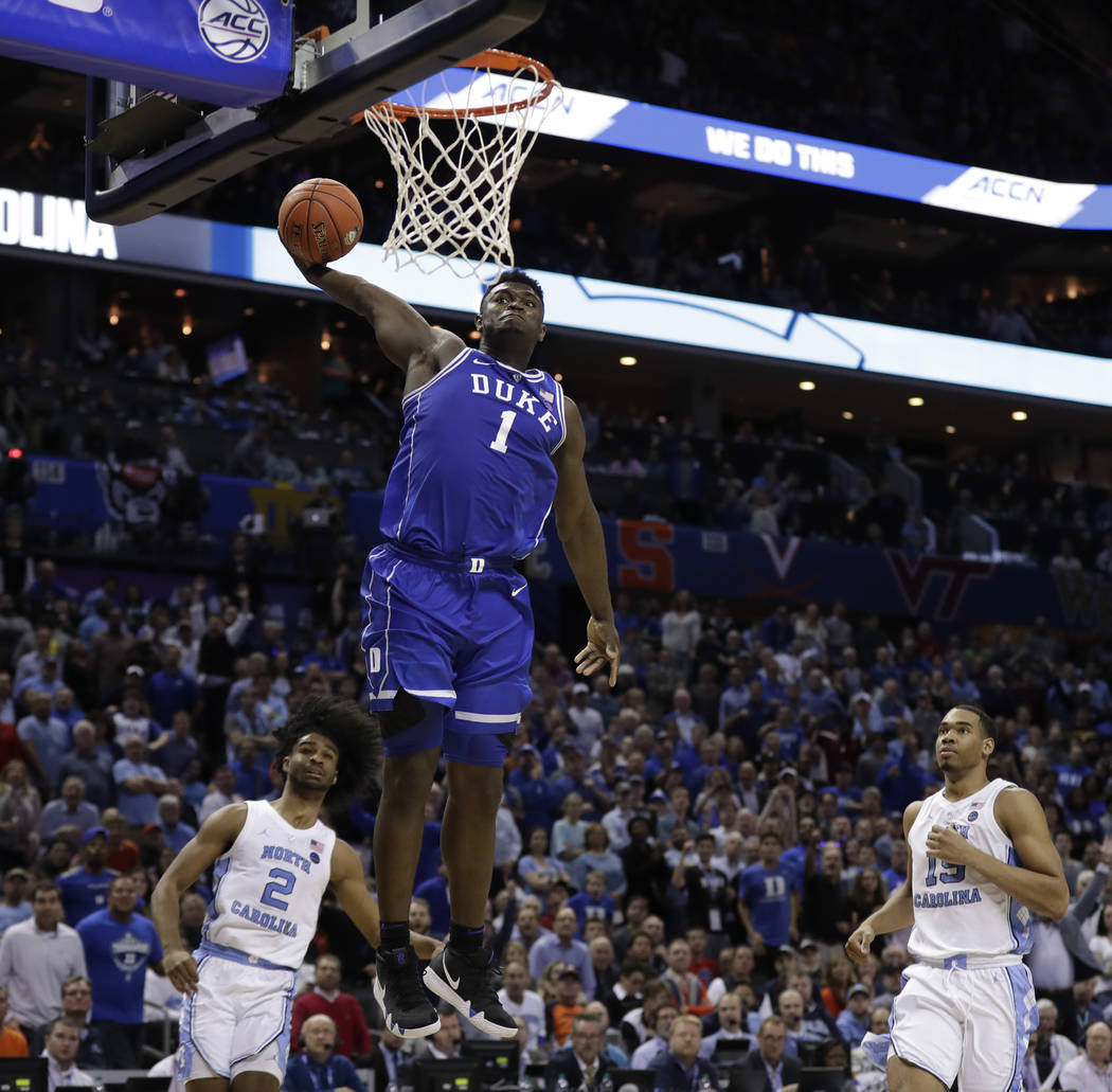 Duke's Zion Williamson (1) dunks against North Carolina during the second half of an NCAA colle ...