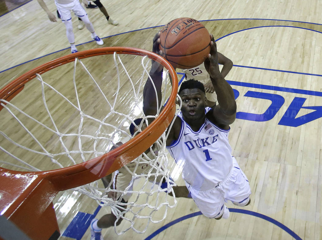 Duke's Zion Williamson (1) goes up to dunk against Florida State during the first half of the N ...