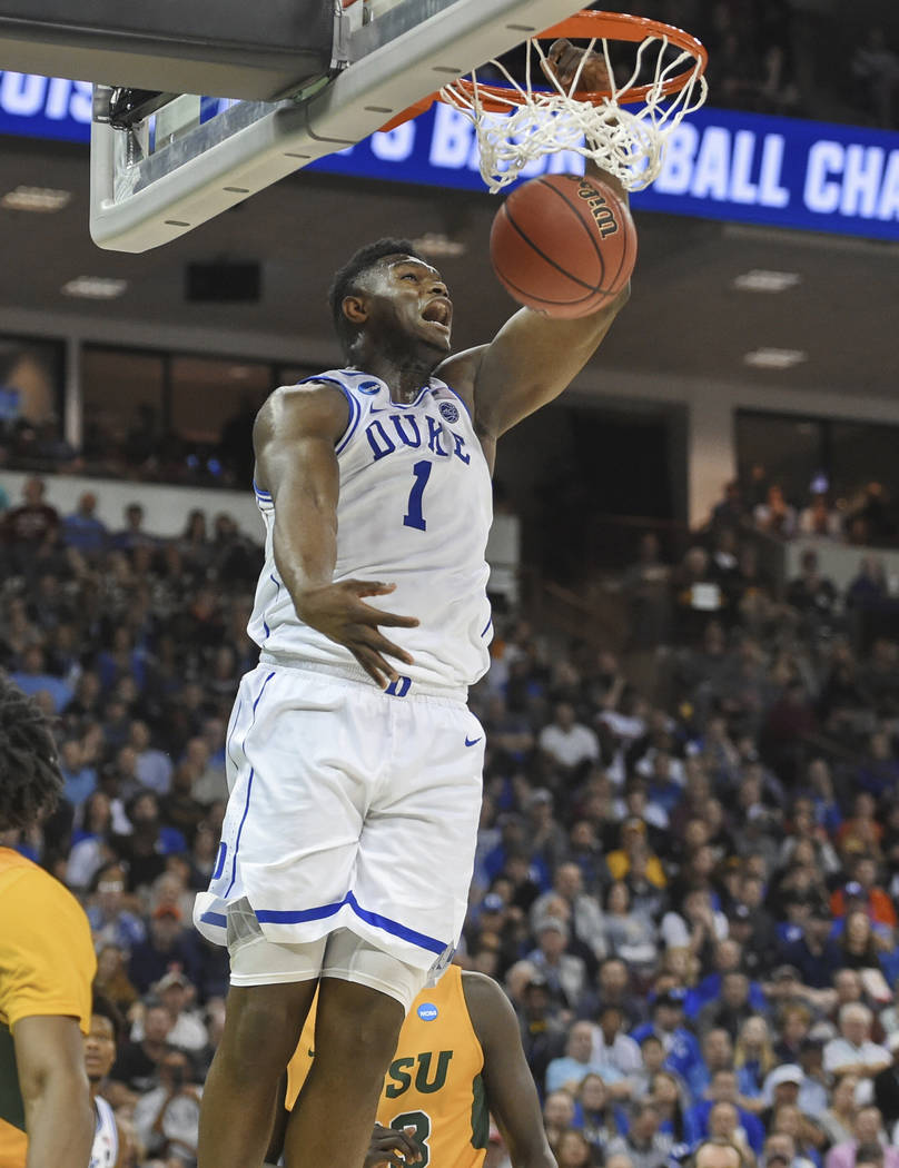 Duke's Zion Williamson dunks against North Dakota State during a first-round game in the NCAA m ...