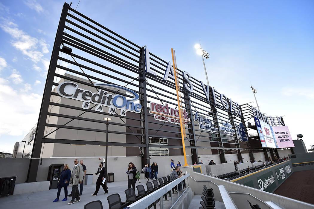 Spectators walk along near left field before the Las Vegas Aviators play the Sacramento River C ...