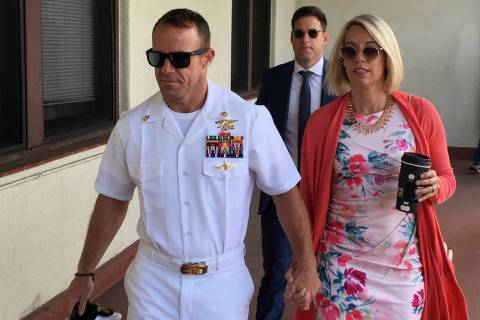 Navy Special Operations Chief Edward Gallagher, left, walks with his wife, Andrea Gallagher as ...