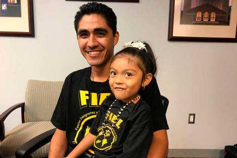 Jose Escobar poses with his daughter Carmen shortly after returning to the United States at Hou ...