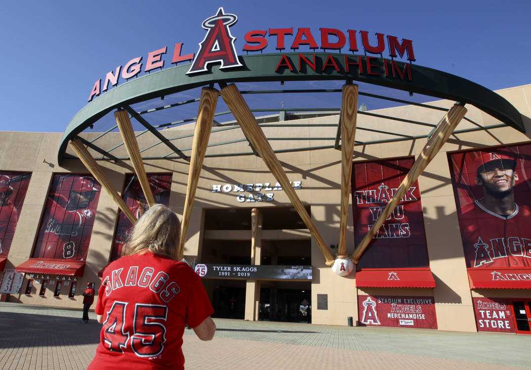 Los Angeles Angel fan Martha Treadway mourns the loss of pitcher Tyler Skaggs at Angel Stadium ...
