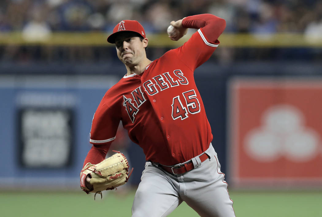 In this June 13, 2019 file photo Los Angeles Angels' Tyler Skaggs pitches to the Tampa Bay Rays ...