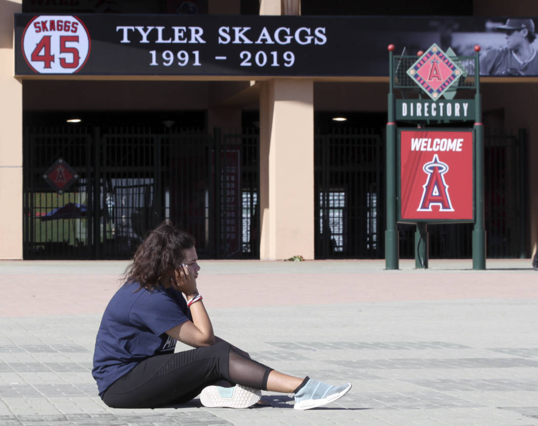 Los Angeles Angels fan Brieanna Gray mourns the loss of pitcher Tyler Skaggs at Angel Stadium i ...
