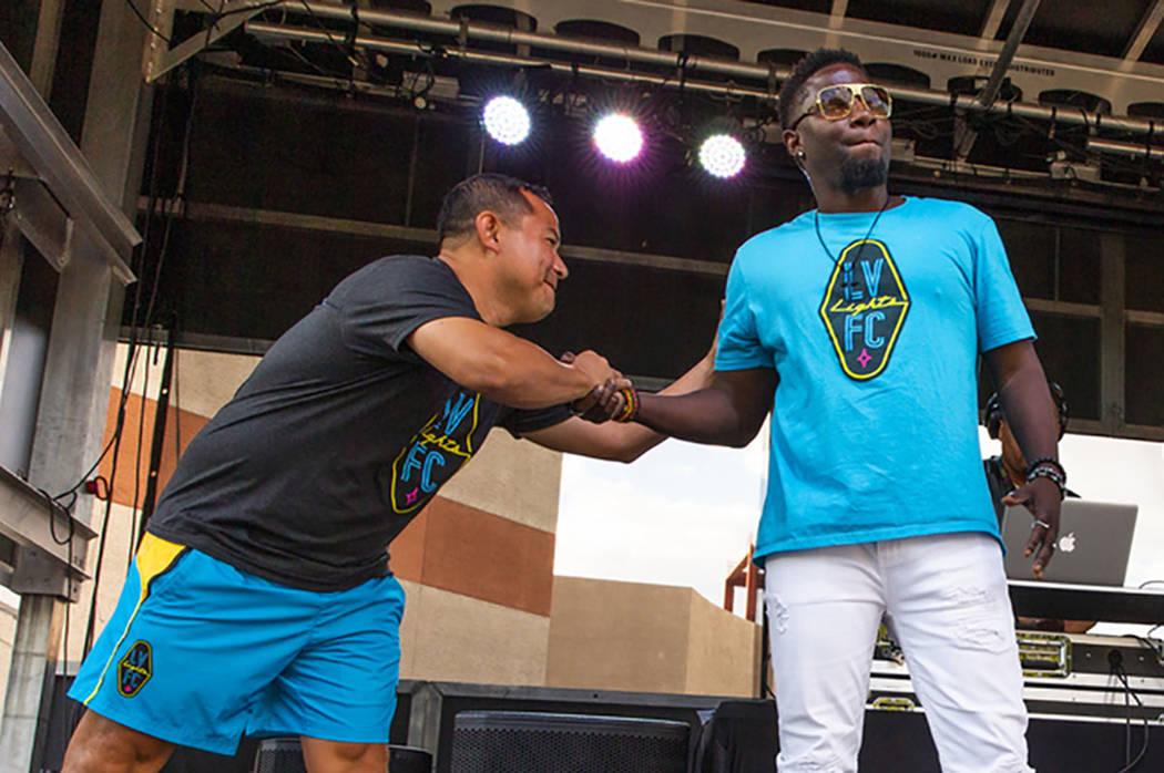 """Las Vegas Lights FC assistant head coach Auggie Rodriguez greets hype man Robert """"Bojo"""" Ackak d ..."""