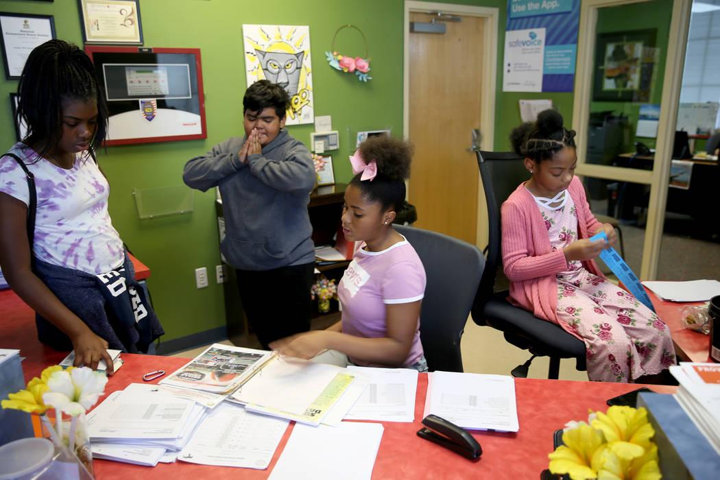 Cherish Bell, 12, from left, Jairo Ramirez, 11, Zariyah West, 12, and Rachel Conner, 10, prepar ...
