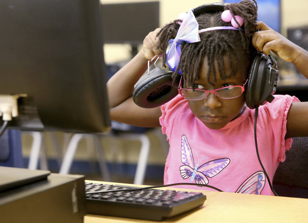 Kindergarten student Gianna Davis prepares to take a test in the library during summer camp at ...