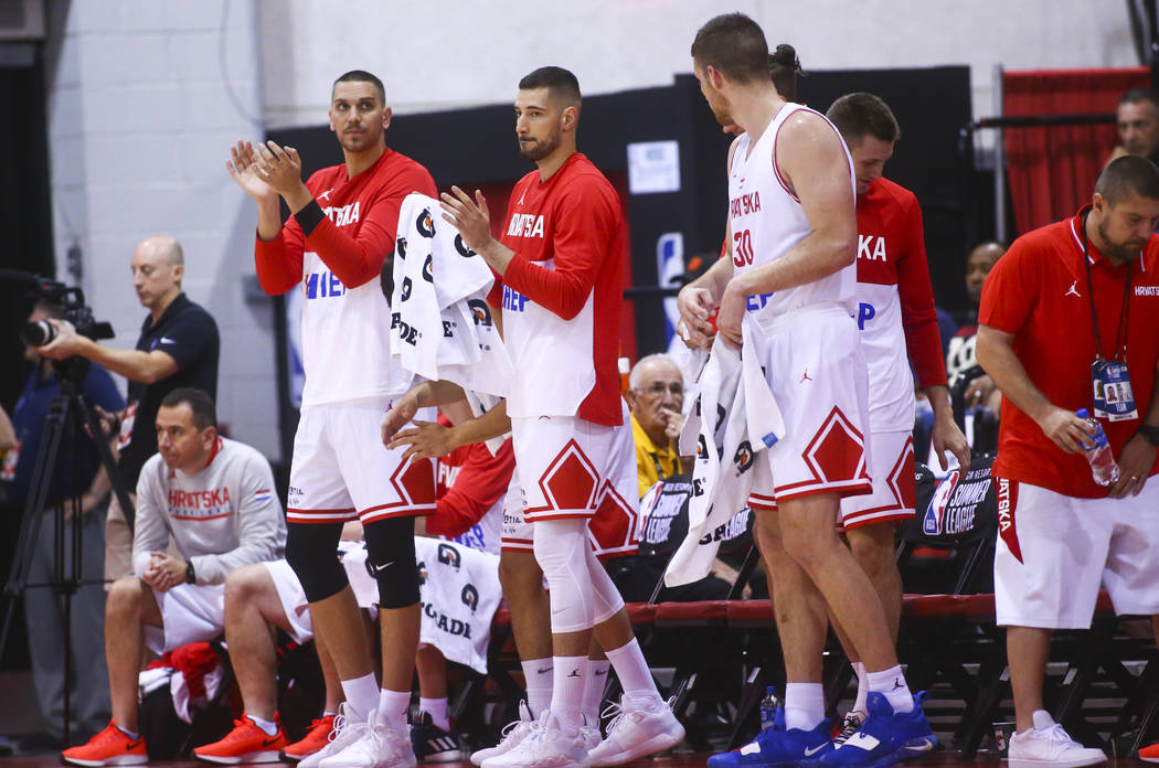 Croatia players cheer on their teammates as they play the Detroit Pistons during the first quar ...