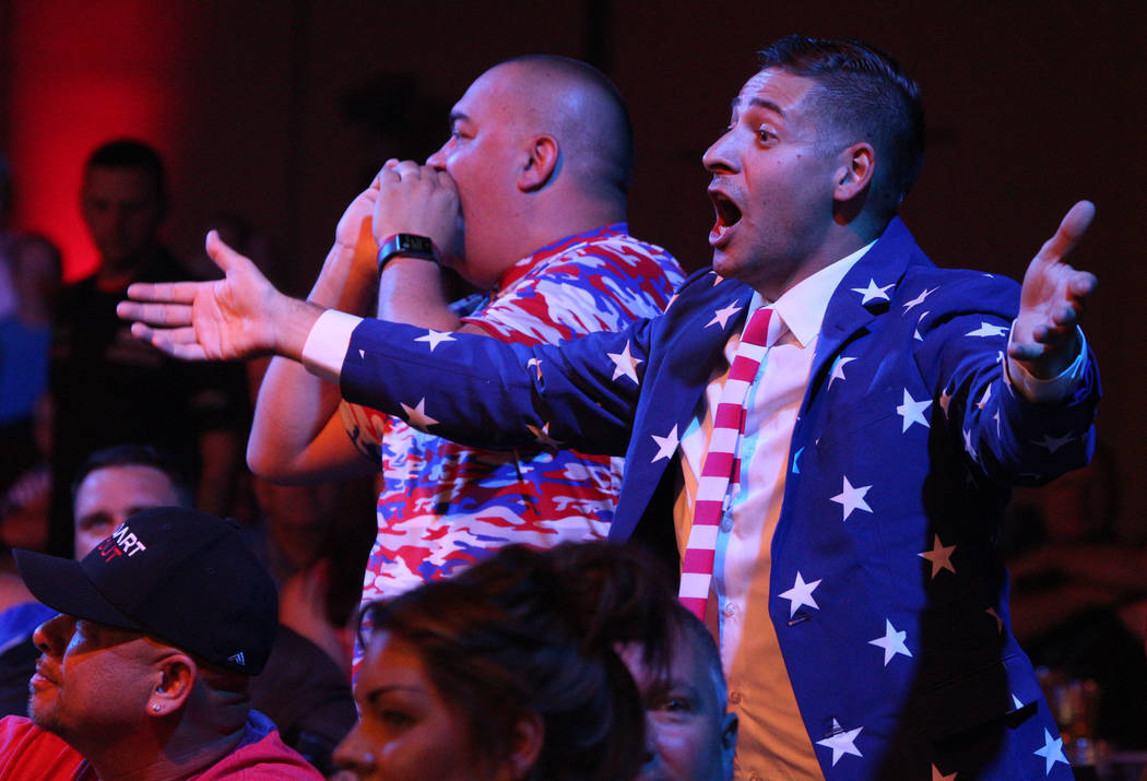 Tony Smeland, left, from Virginia, and Michael Weyant, from Arizona, cheer during the 2019 Dafa ...